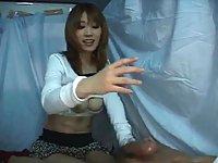 Asian street slut skilled in handjob