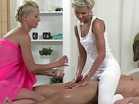Blonde masseuse bends a lesbian over and grabs her by her cunt
