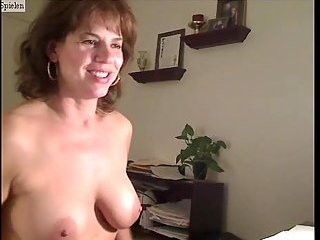 Busty mature pets her snatch