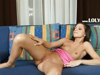 Ultra shocking brunette posing on couch