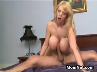 Blonde MILF With huge Fake Breasts
