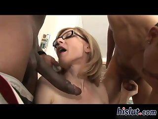 Saucy MILF enjoys two big black cocks